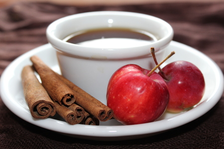 Cup of warming tea with apples and cinnamon