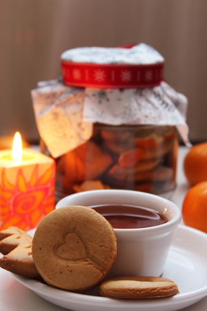 Hot cup of tea with handmade cookies