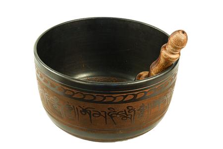 metal Tibetan singing bowl isolated on white background photo