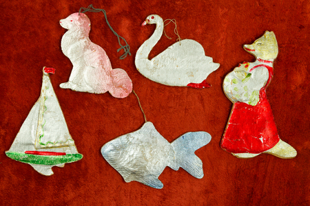 20th century: Old New Years toys on cardboard background teddy scarlet material. middle of the 20th century.