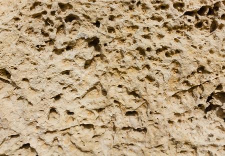 For millennia, weathered sandstone surface in ancient Chersonesos. Seacoast. Crimea, Sevastopol.
