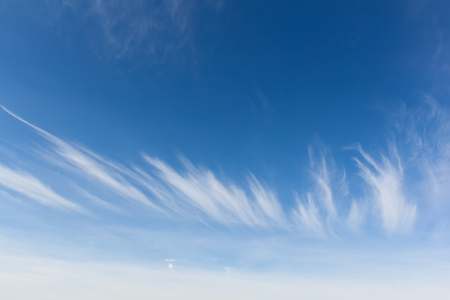 Crown of Cirrus clouds against blue sky. Autumn bright day.
