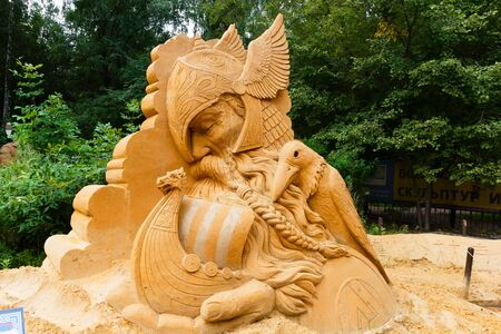 middle ages boat: Sokolniki, MOSCOW, RUSSIA - August 2, 2015: From time immemorial. Russian exhibition of sand sculptures. The composition of Vikings. Author Ivan Zverev.