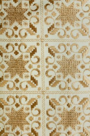 Intricate pattern Lefkariyskogo lace on a white canvas. Mediterranean, Cyprus. Tourism, Travel. Archivio Fotografico