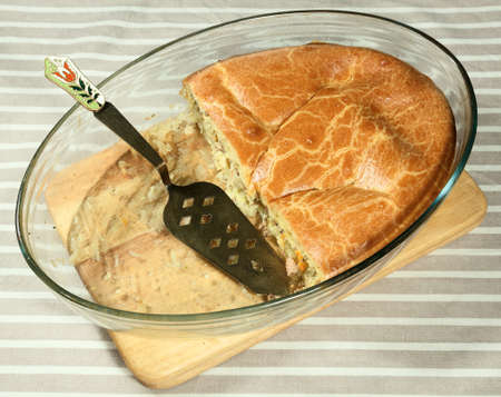 distributing: Fish pie in clear glass baking dish with beautiful distributing blade.