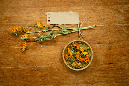 phytotherapy: Calendula.Dried herbs for use in alternative medicine.Herbal medicine, phytotherapy medicinal herbs.For preparation of infusions, decoctions, tinctures, powders, ointments, tea.Background green cloth Stock Photo