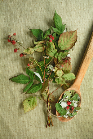 phytotherapy: Raspberry.Dried herbs for use in alternative medicine.Herbal medicine, phytotherapy medicinal herbs.For preparation of infusions, decoctions, tinctures, powders, ointments, tea.Background green cloth