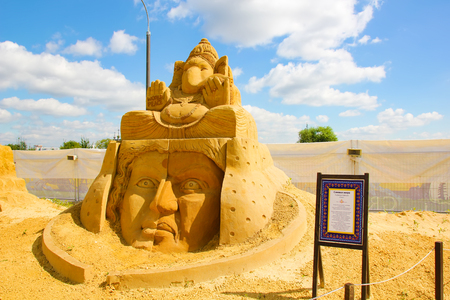 "KOLOMENSKOYE, MOSCOW, RUSSIA-AUGUST 2, 2013:""Mystery of the world"".  Sand sculpture Festival. A symbol of peace. Author (India) Sudarsan Pattnaik."