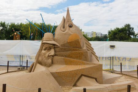 """KOLOMENSKOYE, MOSCOW, RUSSIA-AUGUST 2, 2015:""""Masterpieces of world literature"""". Exhibition of sand sculptures. The Old Man and the Sea by Ernest Hemingway. Author Ruslan Korobkov, Bulgaria"""