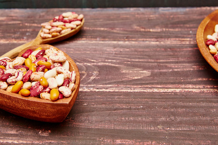 haricot: Haricot beans on wooden table. Healthy food background. Stock Photo