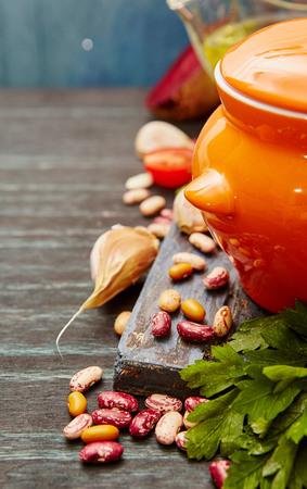 haricot: Cooking concept. Haricot beans, vegetables,oil, herbs and spices on wood. Bio food