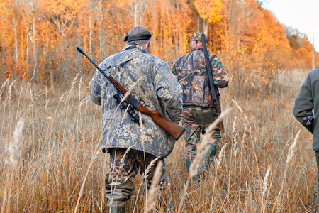 Group of hunters during hunting in forest Stock Photo
