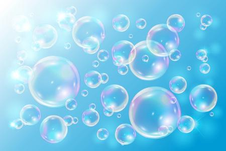 Sprudelt Seife auf blauem Hintergrund. Blasen mit Regenbogenreflexion.