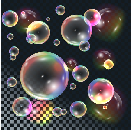Soapy transparent bubbles with rainbow reflection on dark checkered background.