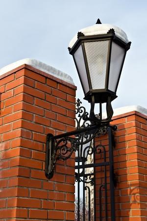 redbrick: Beautiful street lamp at the red-brick wall Stock Photo