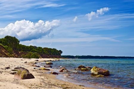 landfall: Baltic beach and dramatic clouds