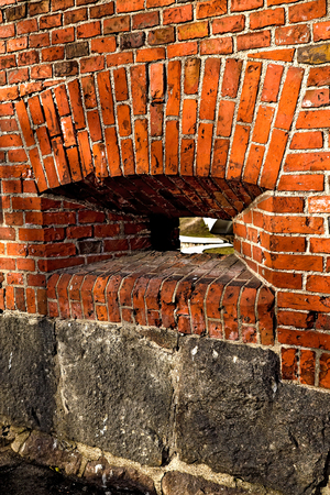 embrasure: Brick wall of the old German Fort with embrasure