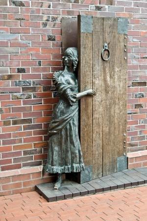 fisherwoman: Sculpture Fisherwoman awaiting the return of her husband from the sea  Fishing village, Kaliningrad, Russia
