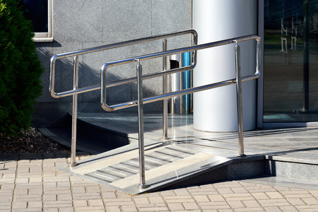 on ramp: Ramp for wheelchair entry with metal handrails