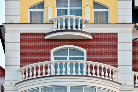 balustrades: White balconies with a balustrade