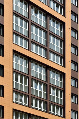 Fragment of new buildings with glazed loggias Stock Photo