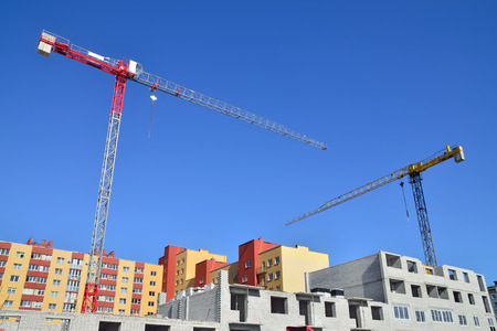 Construction house and crane against of blue sky photo