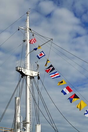 gaff: Mast of the ship and maritime signal flags