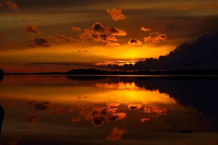 karelia: Beautiful fiery sunset. Lake Pongoma, North Karelia, Russia Stock Photo