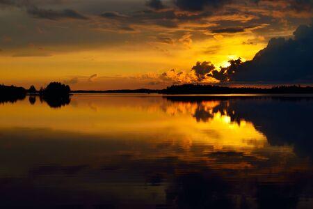 karelia: Orange mirror sunset. Lake Pongoma, North Karelia, Russia
