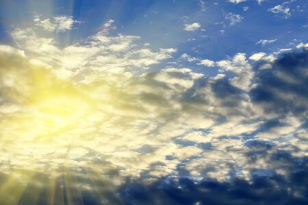 atmospheric phenomena: sun and clouds