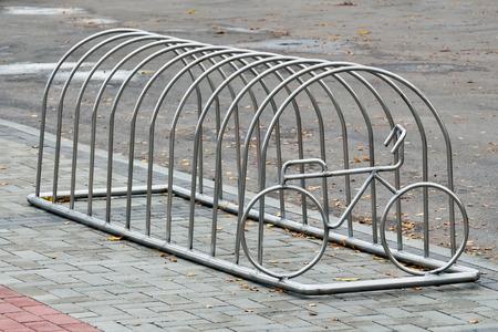 original bike: Modern steel Bicycle Parking with bike image Stock Photo