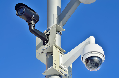 Security camera on blue sky background closeup Stock Photo