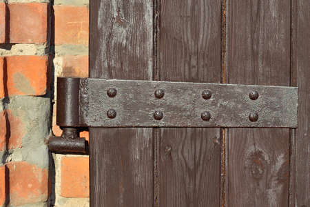 hinge: Old door hinge on wooden door closeup Stock Photo