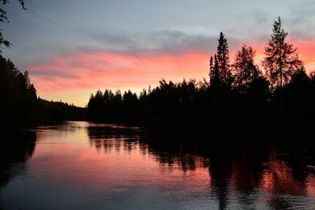 windless: Romantic sunset. River Pongoma. North Karelia, Russia Stock Photo