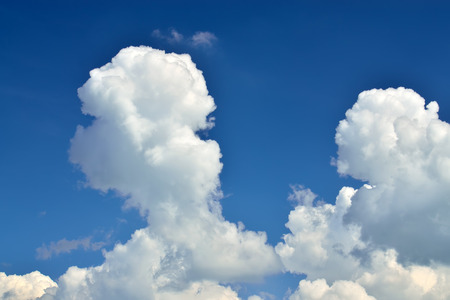 atmospheric phenomena: White Cumulus clouds against blue sky closeup