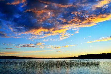 karelia: Beautiful scenic sunset on the lake Momsayarvi. Karelia, Russia Stock Photo