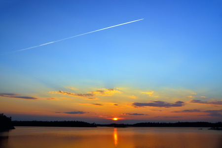 Mark jet aircraft on the background of beautiful Karelian sunset