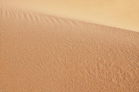 Red sandy dune closeup. Beautiful natural background