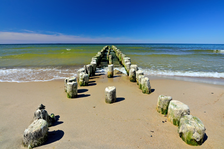 Old German wooden breakwater on the Baltic sea