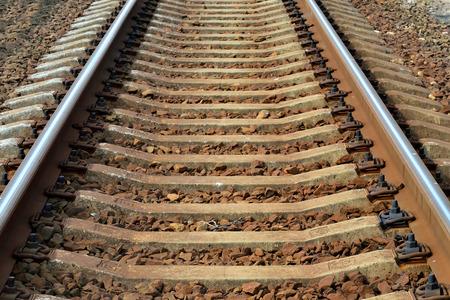 Arrow Rails. Rail and concrete sleepers closeup Standard-Bild