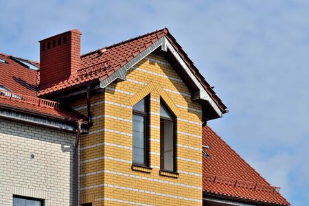 Attic windows on tile roof Stock Photo