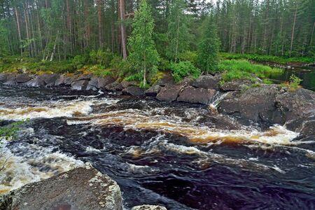 Beautiful Kiviristi threshold on the Ohta river. Karelia, Russia Stock Photo - 145480601