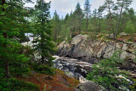 Beautiful Kiviristi threshold on the Ohta river. Karelia, Russia Stock Photo - 145606163