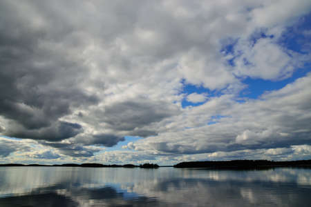 Clouds fly across the sky. Lake Keret, Northern Karelia, Russia