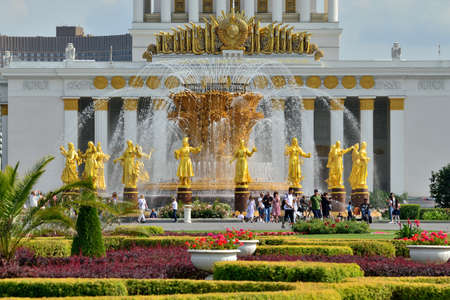Moscow, Russia - august 25, 2020: Fountain Friendship of Peoples with golden statues, the main fountain and one of the main symbols of VDNH Editorial