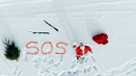SOS-message of Santa Claus in the snowy open space