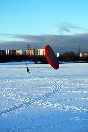 snowkiting: snowkite  in a city         Stock Photo