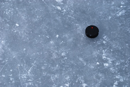 ice rink surface with a puck Stock Photo