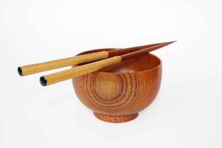 Chopsticks with wooden bowl isolated on white  photo