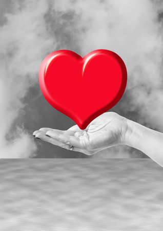 hand holding red heart, love or medical concept on black white background Stock Photo